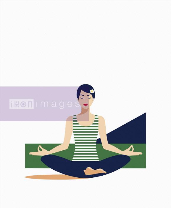 Woman meditating in lotus position - Bahar