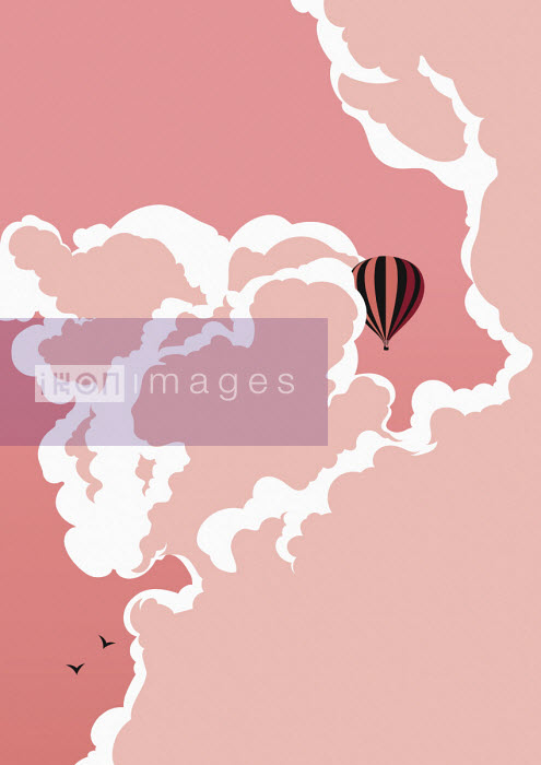 Hot air balloon floating in pink sky - Bahar