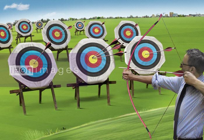 Businessman hitting lots of targets - Derek Bacon