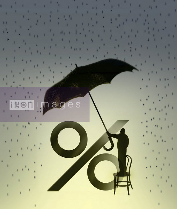 Gary Waters - Man holding umbrella over percentage sign