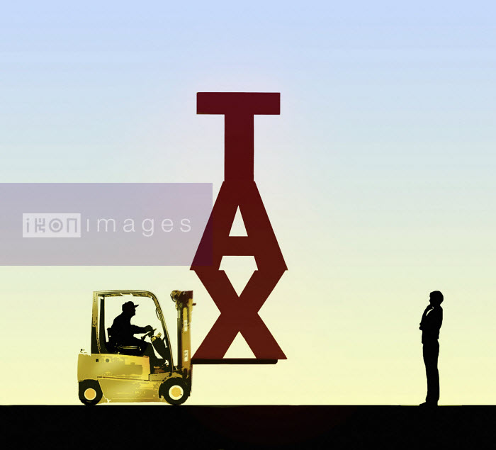 Man contemplating the word Tax on forklift truck - Gary Waters