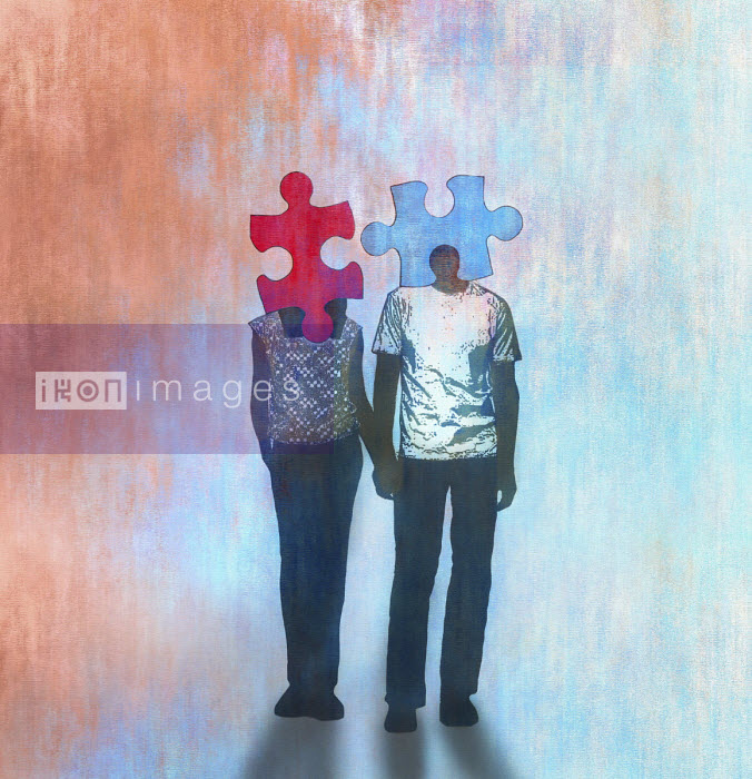 Gary Waters - Young couple holding hands with matching jigsaw puzzle piece heads