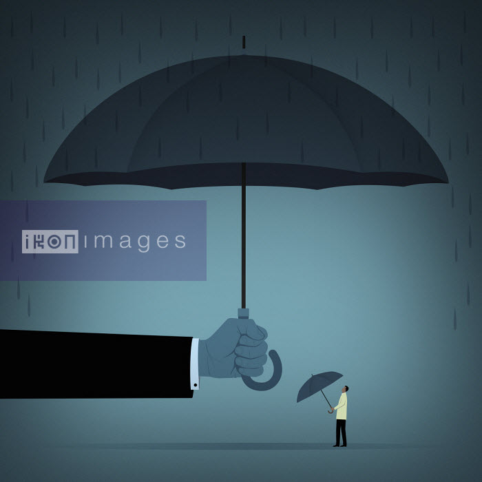 Hand holding large umbrella over man with small umbrella Mark Airs
