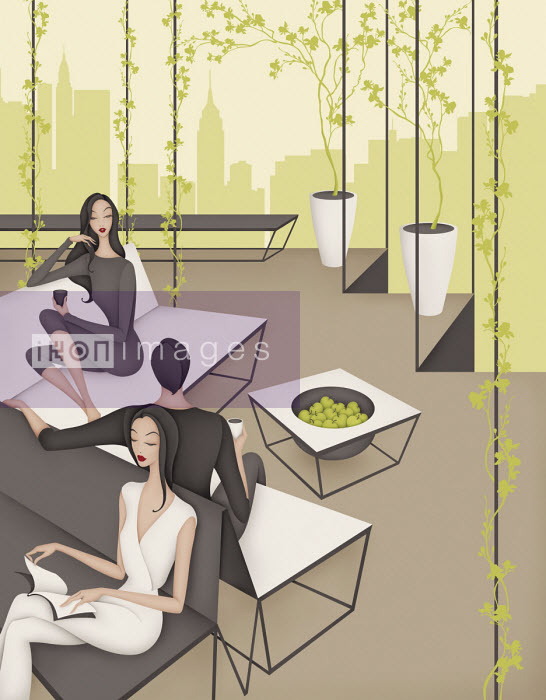 People relaxing in sophisticated modern hotel lounge - Wai