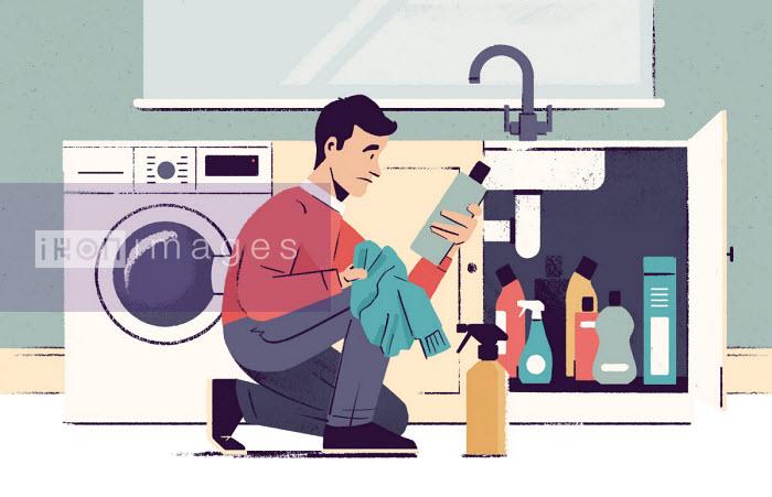 Man reading label of laundry product Paul Reid