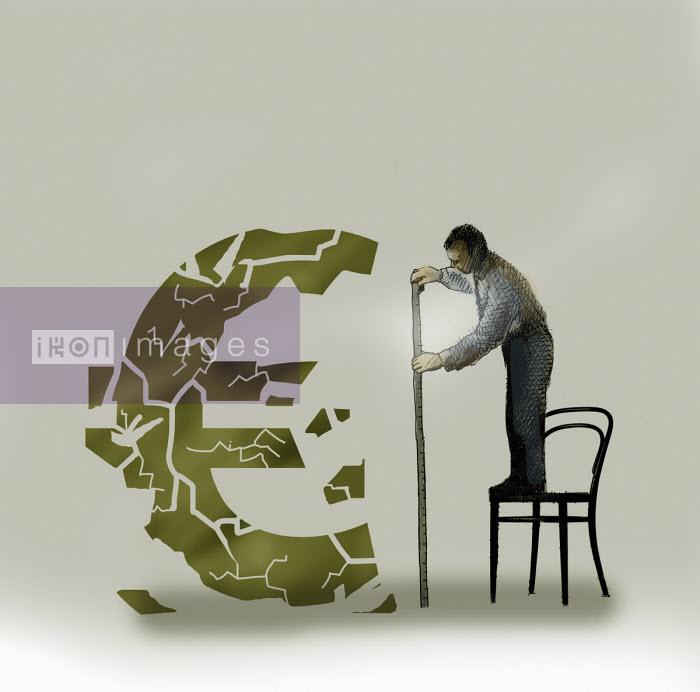 Man measuring crumbling euro sign Gary Waters