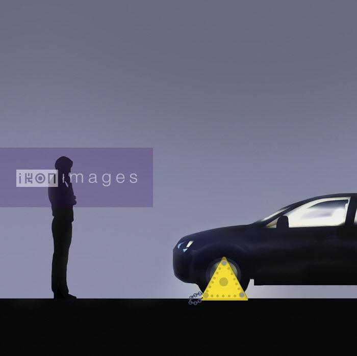 Man looking at clamped car - Gary Waters