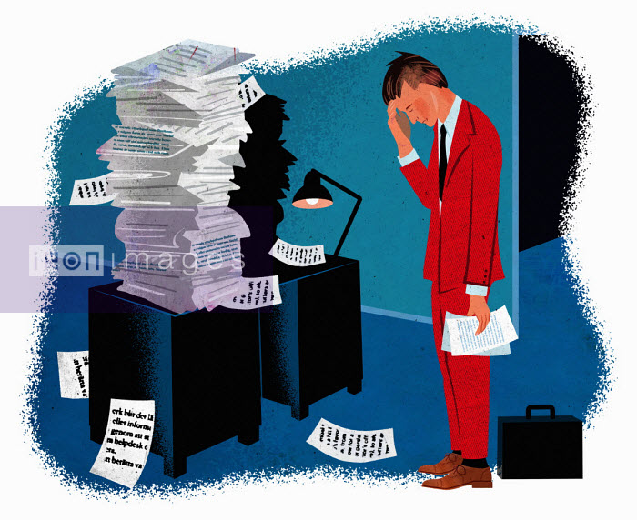Businessman in despair at pile of paperwork - Jens Magnusson