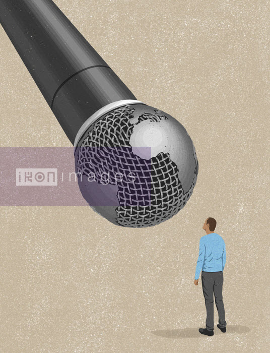 John Holcroft - Man using large global microphone