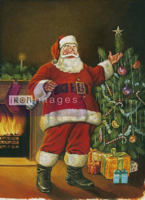 Traditional Father Christmas standing beside Christmas tree