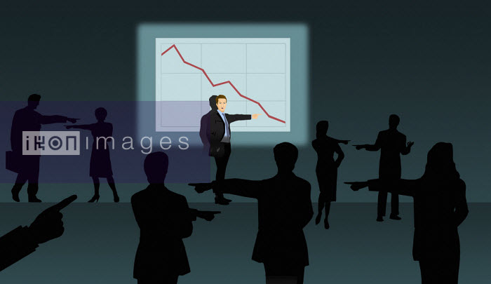 Business people pointing the finger of blame for bad performance