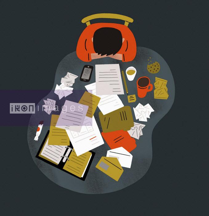 Overhead view of man struggling with paperwork - Robert Hanson