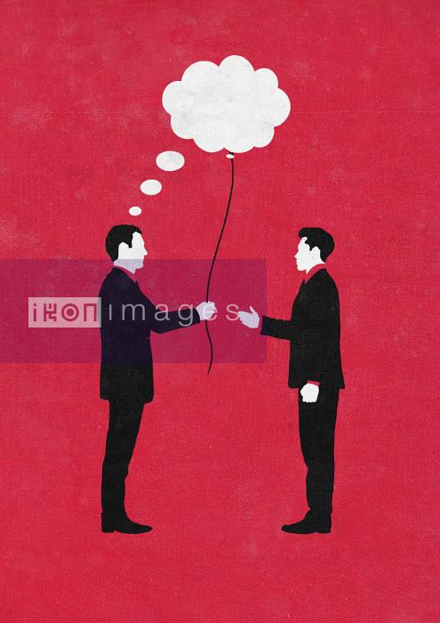 Sergio Ingravalle - Businessman giving thought bubble balloon to colleague