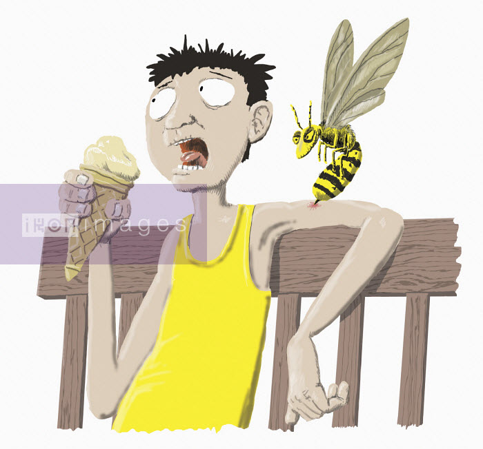 Man being stung by wasp while eating ice cream - Andrew Pinder