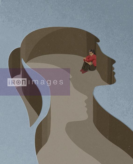 Girl cowering inside her head - John Holcroft
