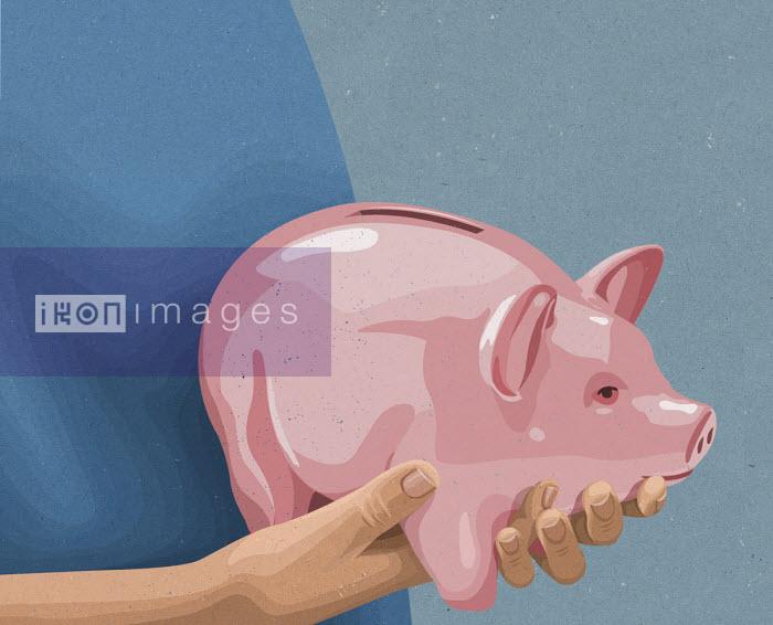 John Holcroft - Hands holding piggy bank