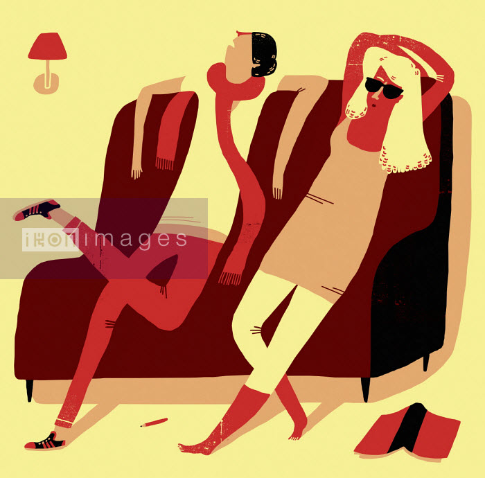 Oivind Hovland - Couple relaxing on sofa