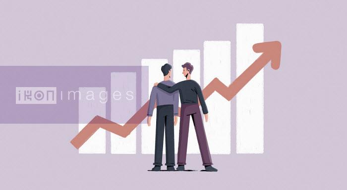 Paul Reid - Businessman congratulating colleague for successful graph
