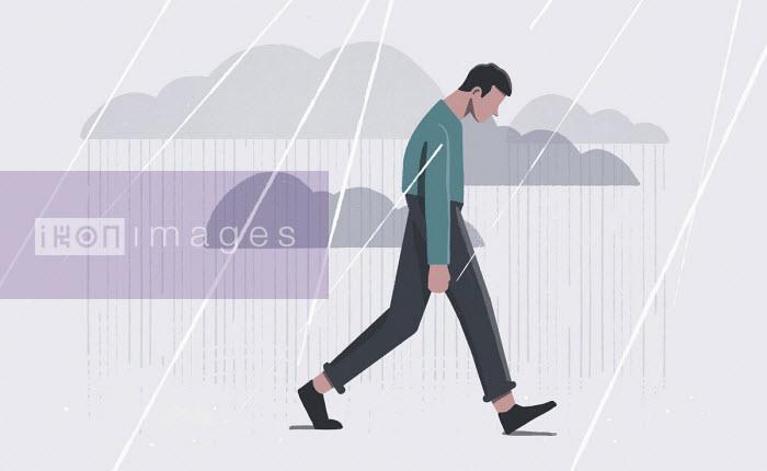 Depressed man walking in rain - Paul Reid