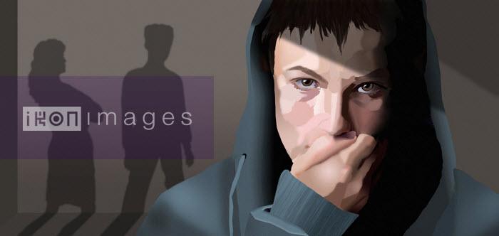 Teenage boy upset while parents argue