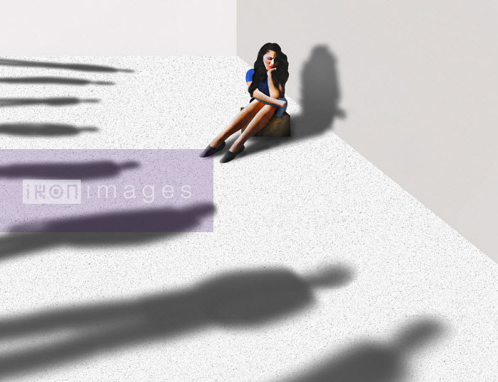 Woman surrounded by ominous shadows