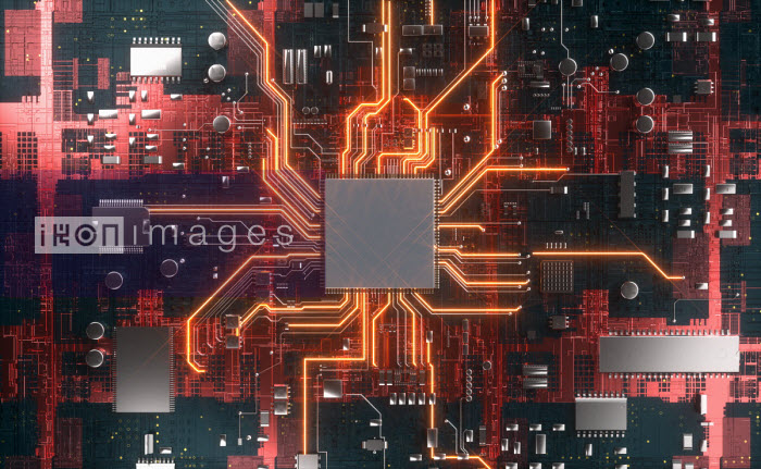 CPU in the centre of glowing high tech computer circuit board - Oliver Burston