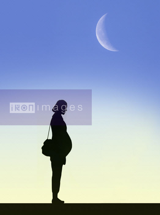 Moon in sky above silhouette of pregnant woman - Gary Waters