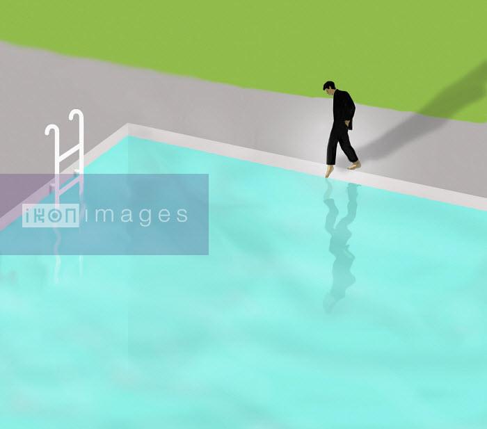 Gary Waters - Businessman putting toe in swimming pool water