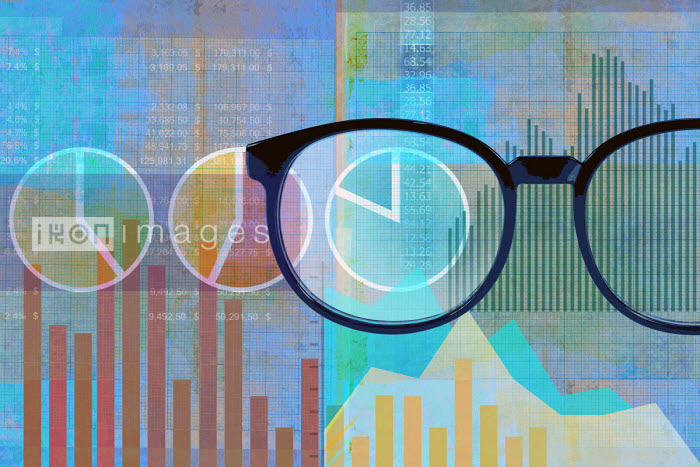 Roy Scott - Pair of glasses examining financial data