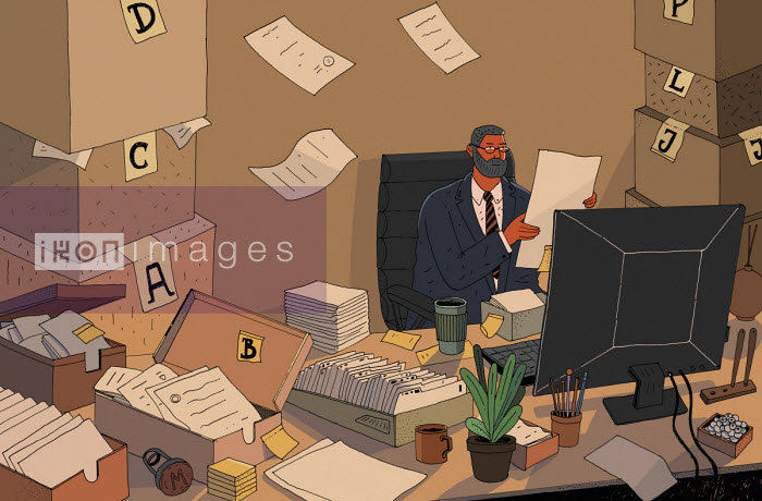 Maxim Usik - Overworked businessman with piles of paper