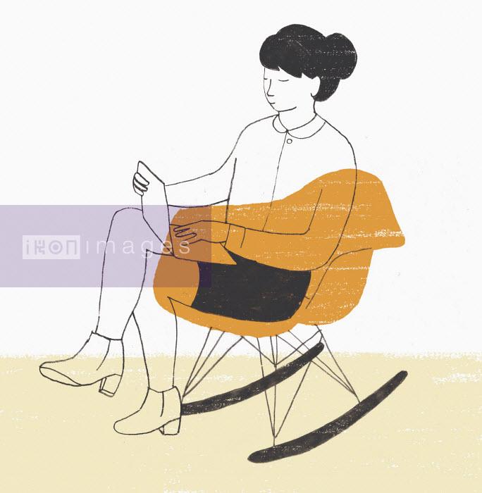 Woman working on laptop sitting in modern rocking chair - Rosie Scott
