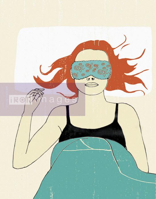 Woman in bed wearing sleep mask - Rosie Scott