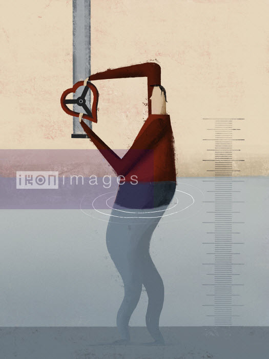 Man standing in water turning heart shaped water supply valve - Josep Serra