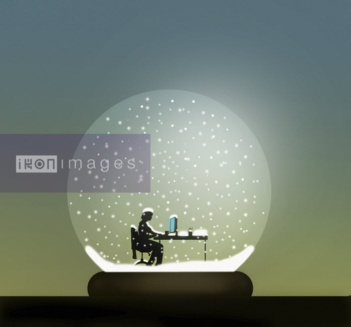 Gary Waters - Businesswoman working at desk inside of snow globe