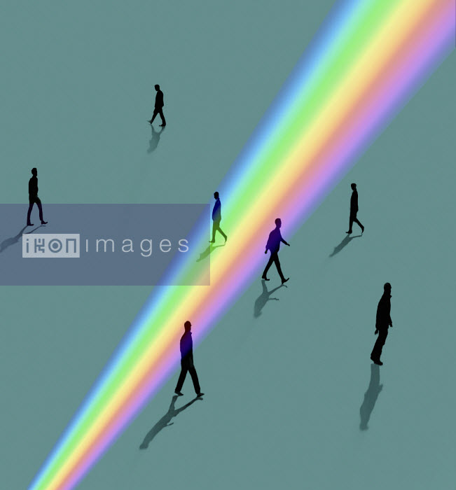 Silhouettes of people walking through rainbow light - Gary Waters
