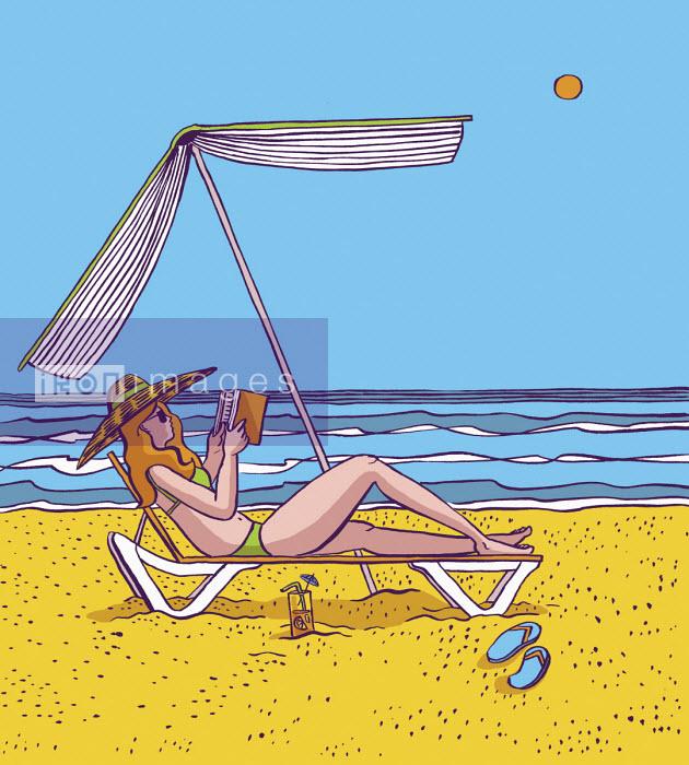 Woman reading under book parasol on beach - Dom McKenzie