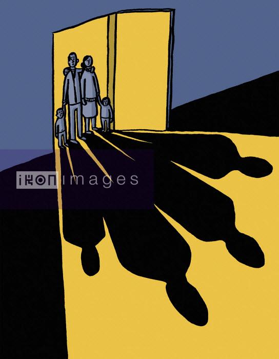 Dom McKenzie - Young family lit up in doorway of empty room