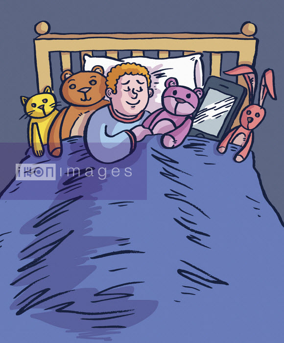 Child asleep in bed with soft toys and digital tablet - Dom McKenzie