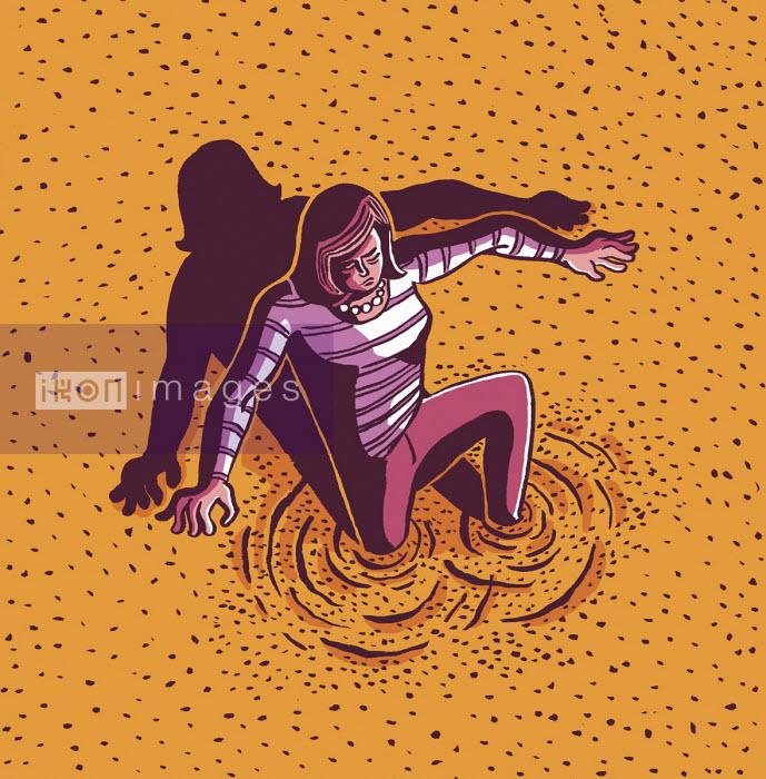 Dom McKenzie - Woman sinking into quicksand