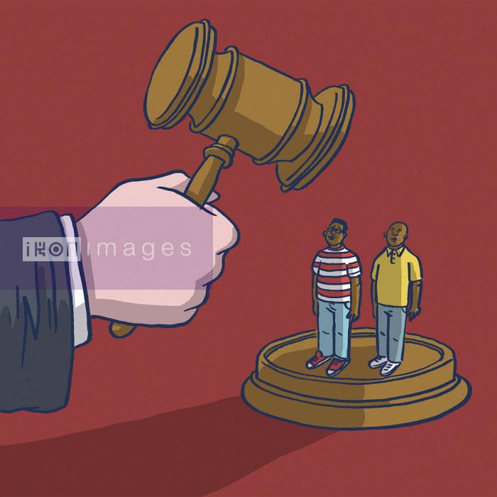 Hand holding gavel over two men - Dom McKenzie