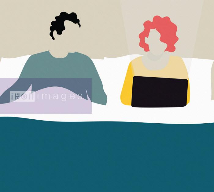 Annalisa Grassano - Woman working on laptop in bed ignoring partner