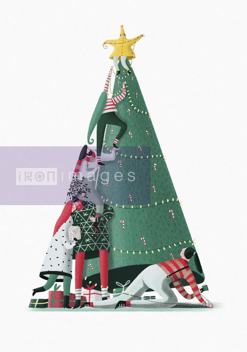 Friends decorating tall Christmas tree together - Lorenza Cotellessa
