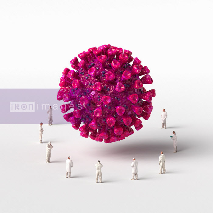 Healthcare workers surrounding giant computer generated coronavirus - Oliver Burston