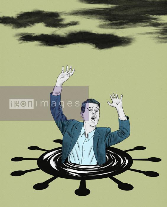 Businessman drowning in coronavirus puddle - Thomas Kuhlenbeck