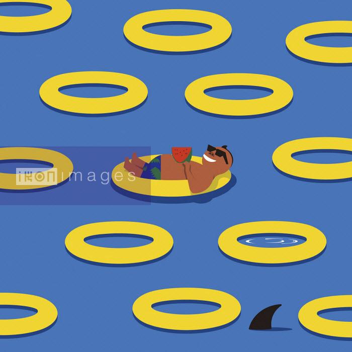 Man floating on rubber ring unaware of shark - Yenpitsu Nemoto