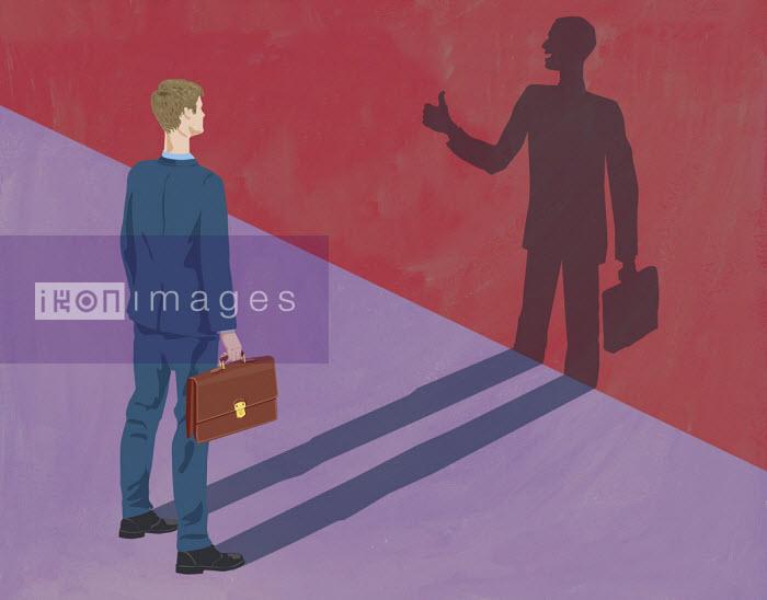 Businessman looking at encouraging shadow - Gary Bates