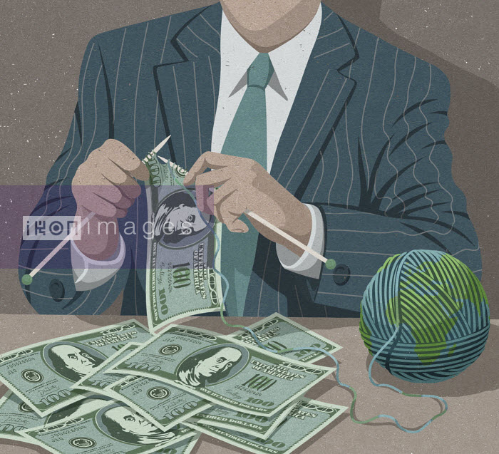 Businessman knitting one hundred dollar bills using globe ball of wool - John Holcroft