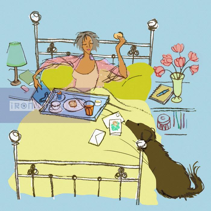 Woman enjoying birthday breakfast in bed - Jan Bowman