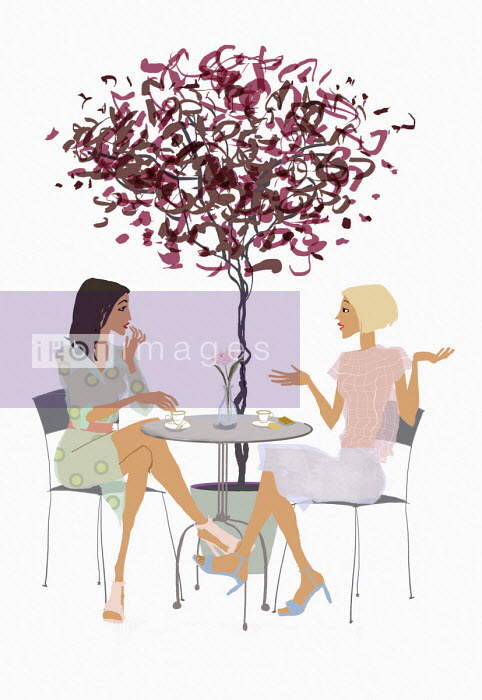Two friends chatting at pavement cafe table - Jan Bowman