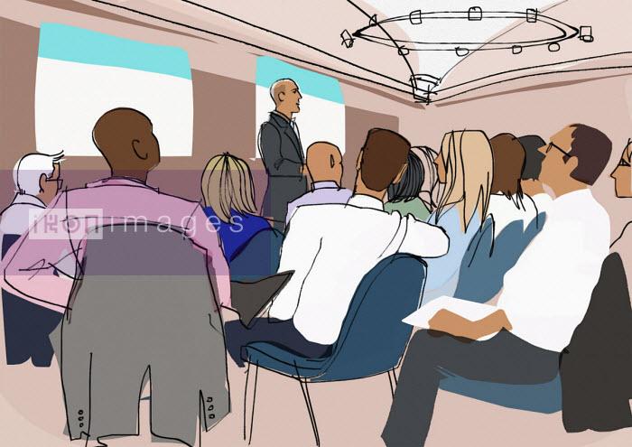 Man giving presentation to group - Jan Bowman